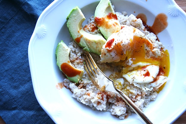 savory breakfast oatmeal with avocado, chipotle cholula and a runny yolk