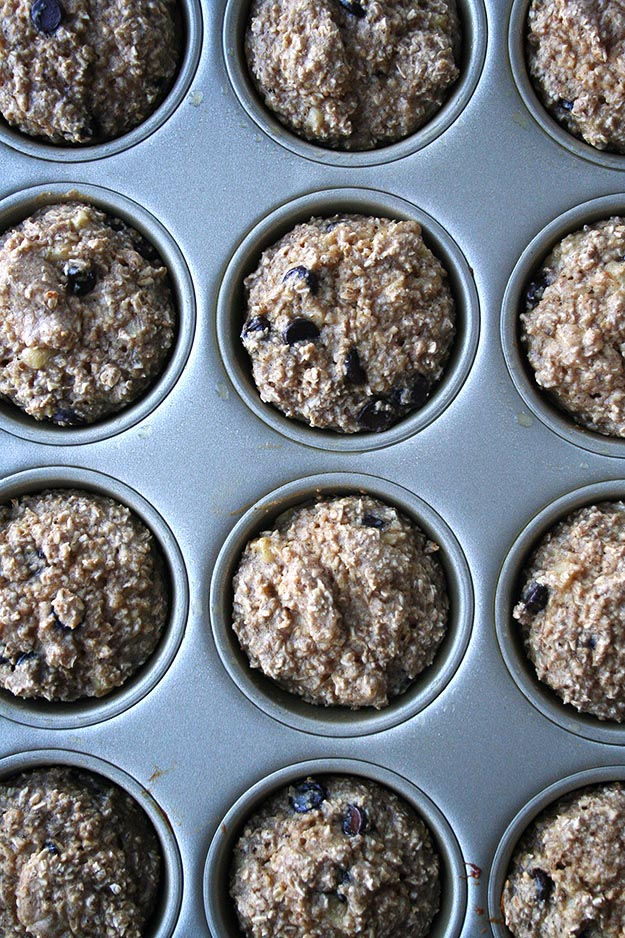 a close up on a dozen banana muffins made with oat flour and chocolate chips