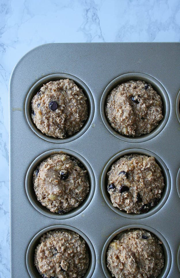 banana oat muffins topped with chocolate chips fresh out of the oven!