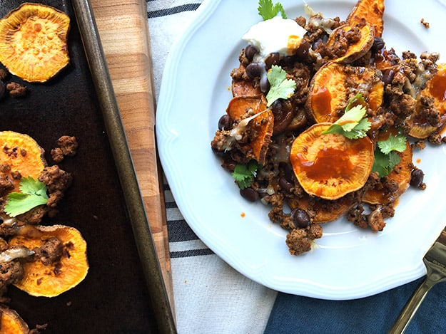 plated and sun-laden sweet potato nachos with mexican spiced ground turkey