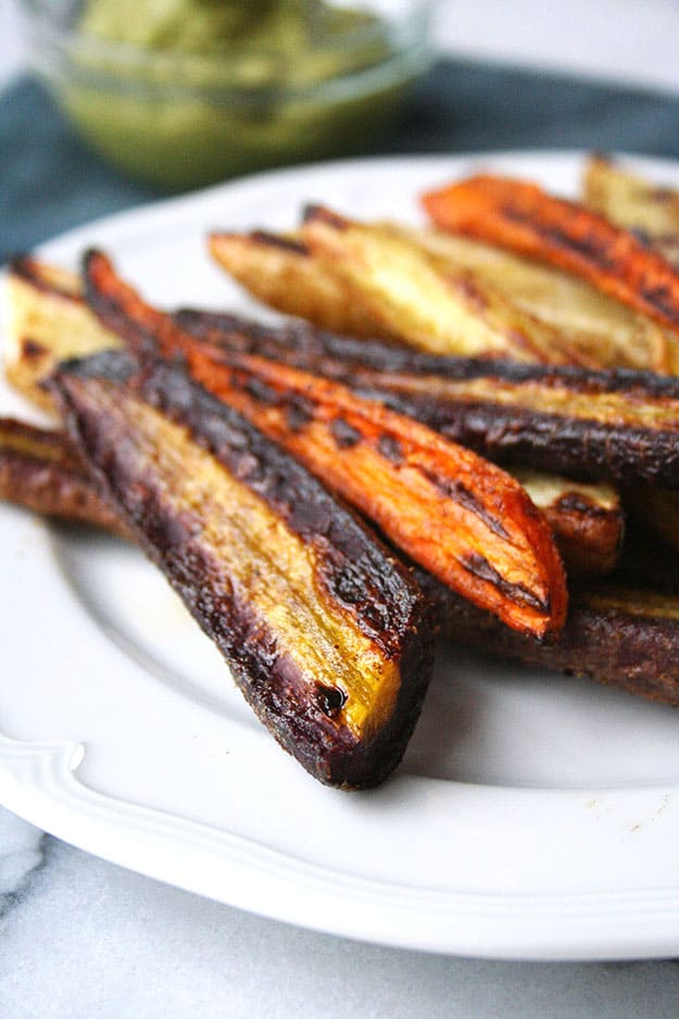 zoomed in on the crispy edge of a purple carrot roasted with salt pepper and cumin