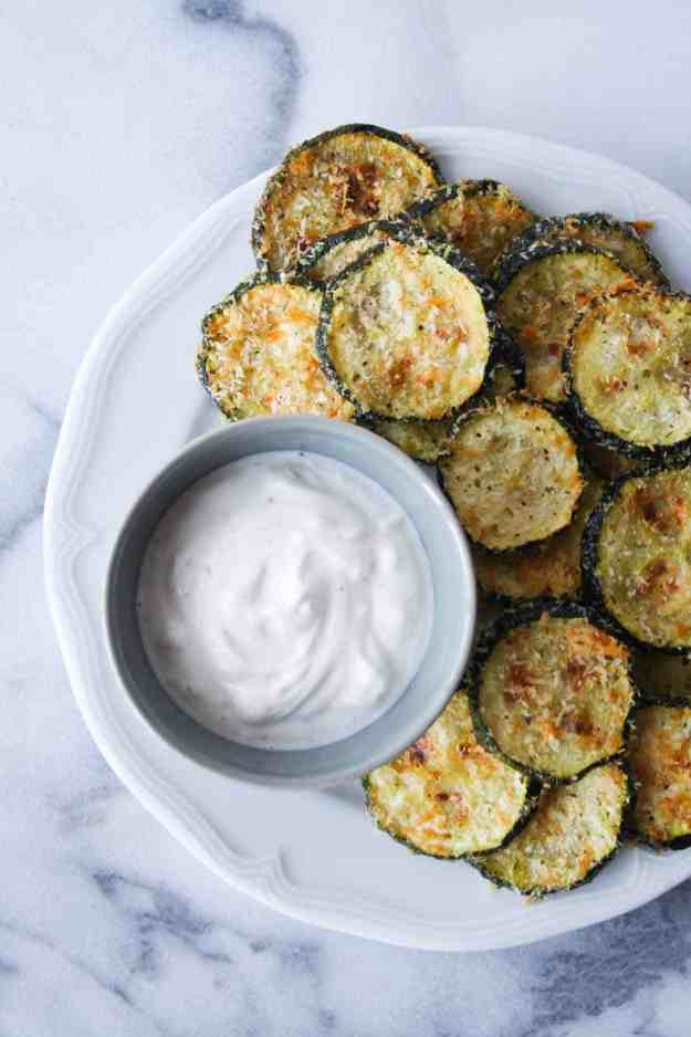 Simple and healthy BAKED zucchini chips with a leom yogurt sauce - a perfect snack or side! | Hungry by Nature