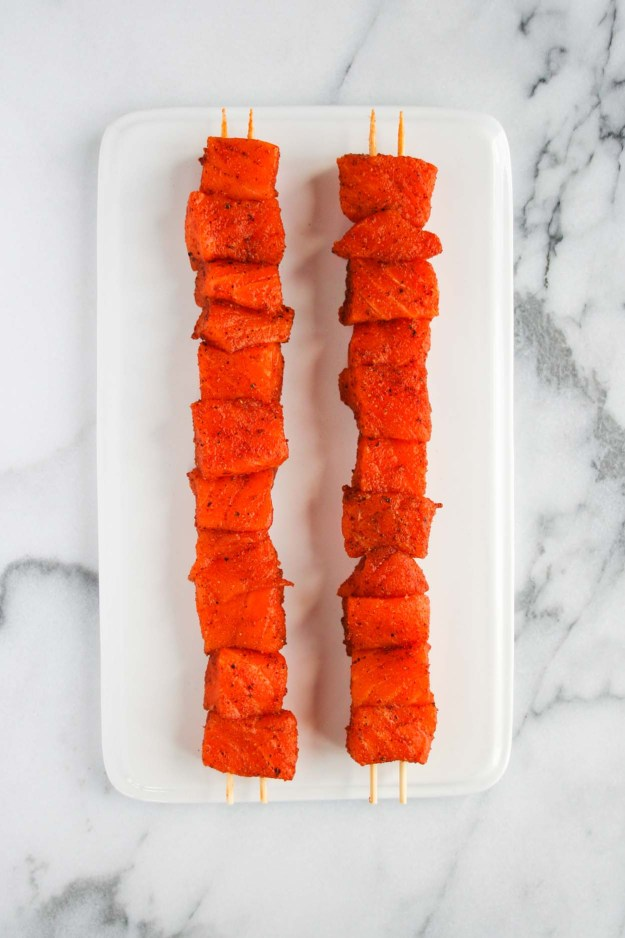 Spiced, skewered and ready for the grill - Cajun Salmon Tacos! | hungrybynature.com