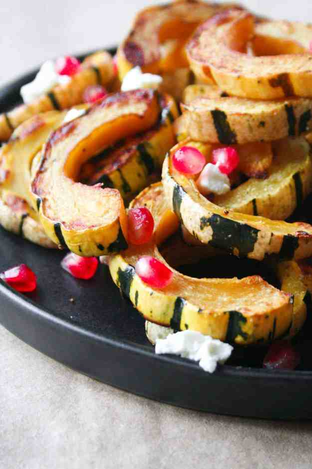 Simple roasted delicata squash with goat cheese and pomegranate seeds is the easiest fall side dish to add to any dinner! | hungrybynature.com