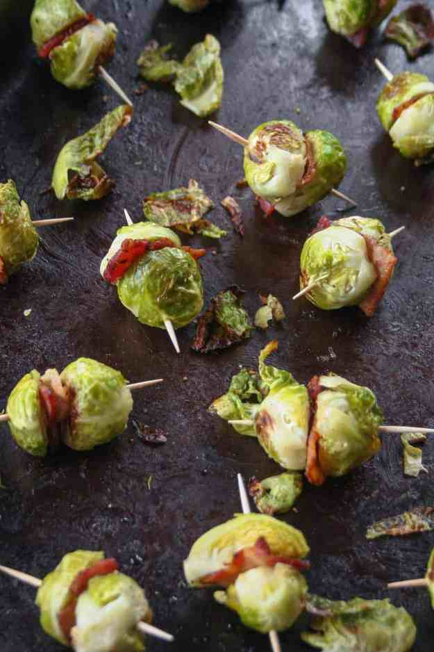 Bite size and packed with flavor, these brussels sprouts and bacon skewers are easy to put together and the perfect appetizer for your holiday party! | hungrybynature.com