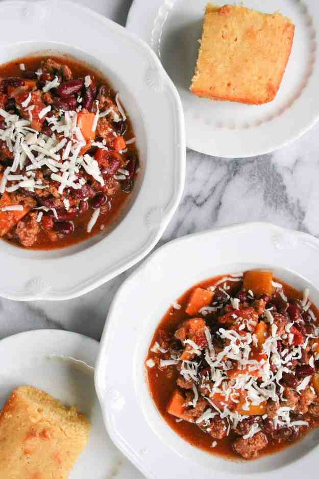crock pot turkey chili in bowls with cornbread