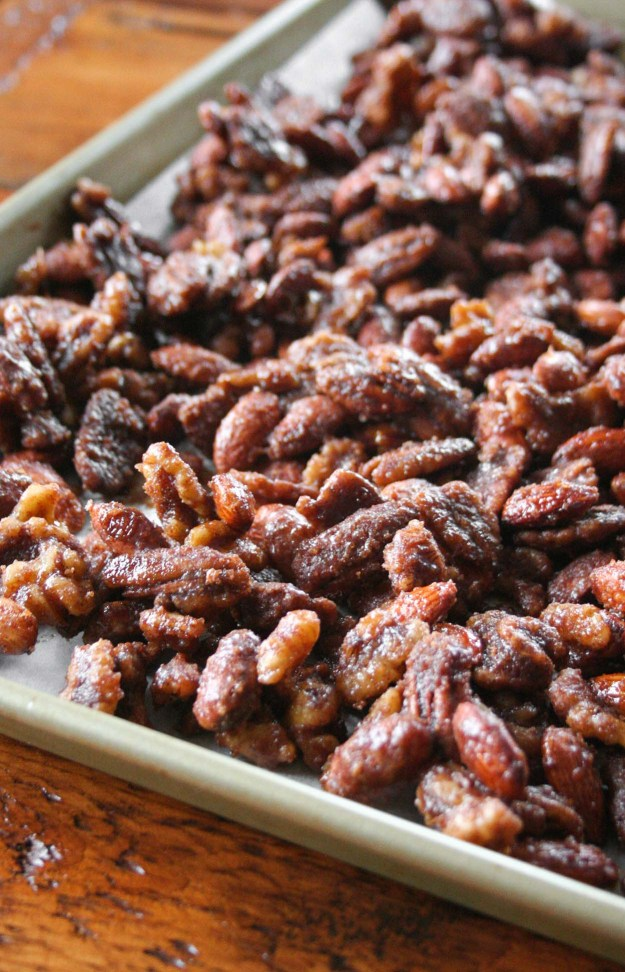 Candied mixed nuts are a simple and sweet way to spread holiday cheer. This sweet treat is made in your slow cooker and is the perfect Christmas gift! | hungrybynature.com