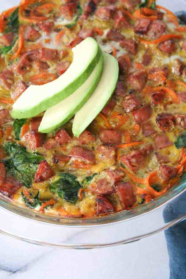Nothing beats the perfect bite of this paleo and Whole30 compliant sweet potato spinach and chicken sausage frittata. It is loaded with healthy ingredients and will beat the breakfast blues! | hungrybynature.com