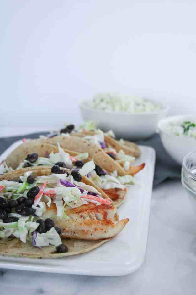 Fish Tacos with Cilantro-Lime Cauliflower Rice | cabbage, tilapia, easy, crispy, healthy, recipe | hungrybynature.com