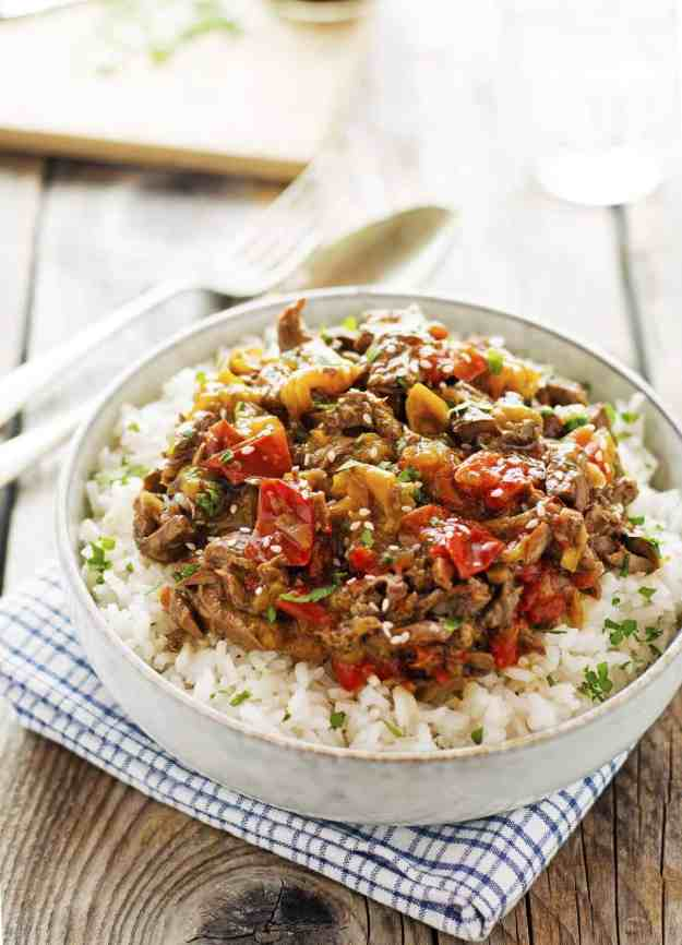 paleo slow cooker pepper steak on a bowl with rice