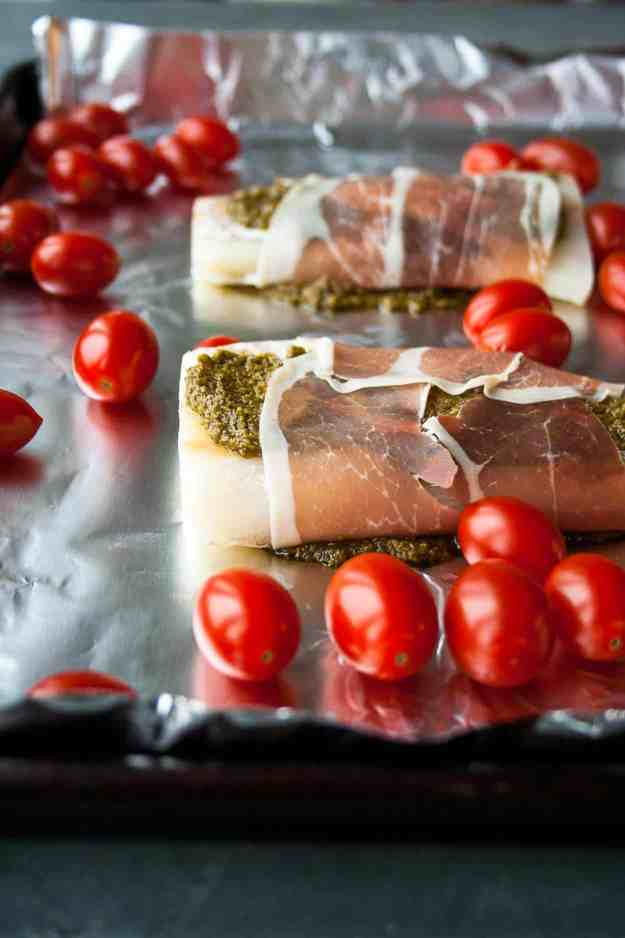 Prosciutto Wrapped Cod with Blistered Tomatoes | #sheetpandinner #paleo #sea2table #fish | hungrybynature.com