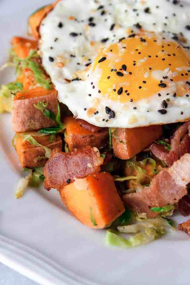 Brussels Sprout Hash with Sweet Potato and Bacon {Whole30!} | #whole30 #paleo #breakfast #brunch #hash #castiron #eggs | hungrybynature.com