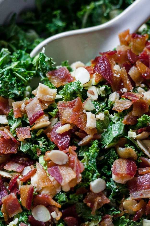 close up of a bowl of shaved brussels sprout salad with kale, bacon and a creamy tahini dressing