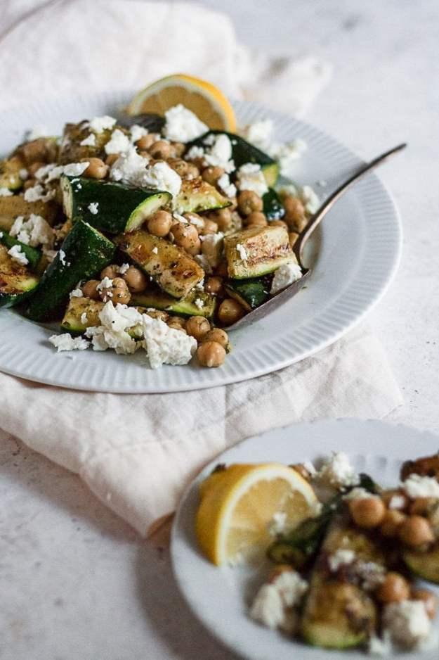 mediterranean grilled zucchini salad on plates