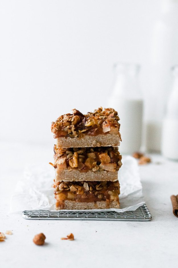 stack of three paleo apple pie bars with crumble