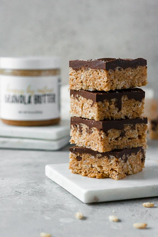 granola butter chocolate crispy rice bars stacked