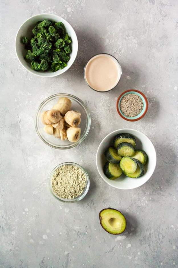 creamy green smoothie ingredients in bowls