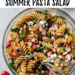 overhead shot of simple greek summer pasta salad with two spoons with text overlay