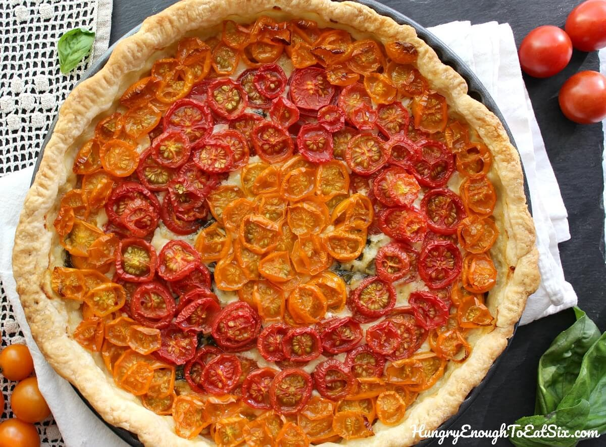 The beautiful flavors of basil and sweet tomatoes come together in this cheesy tart!