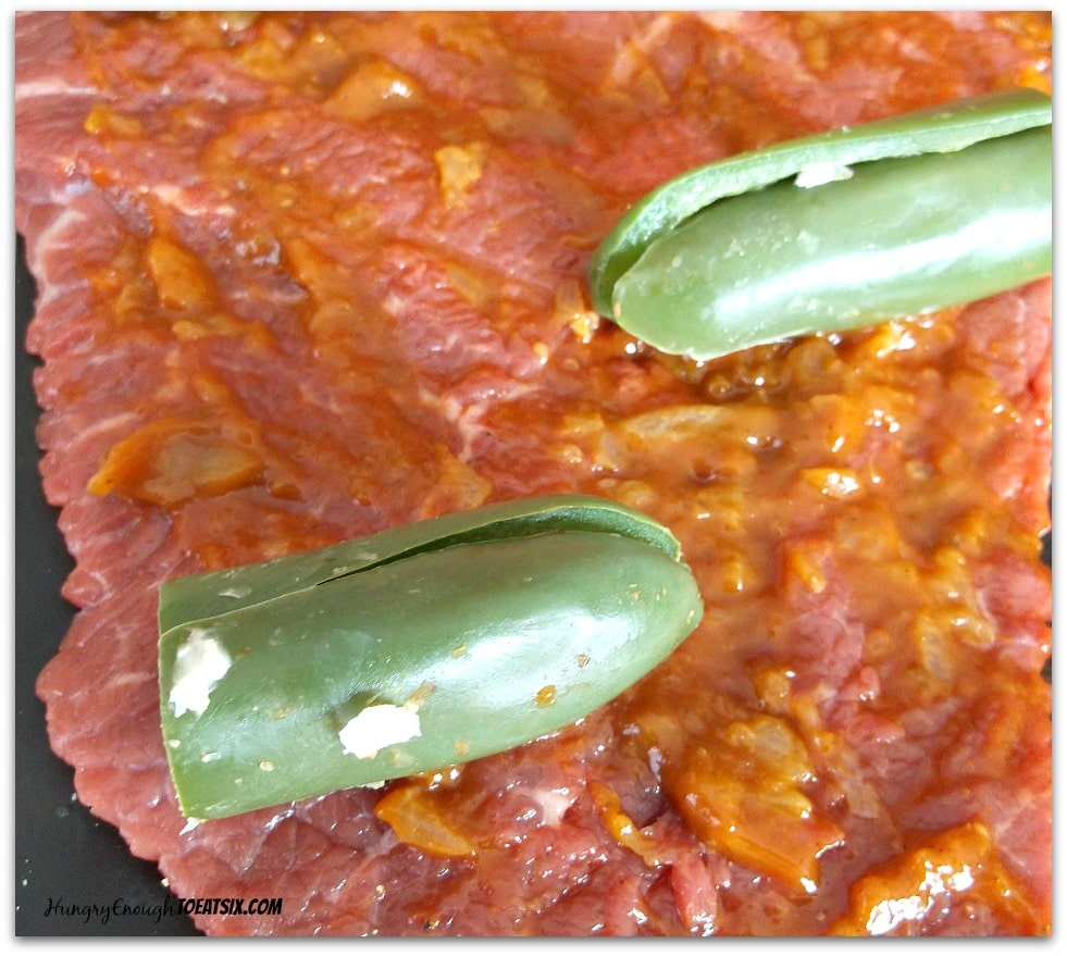 London broil spread with chipotle sauce, and the jalapenos placed on top.