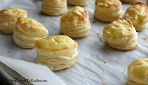 An easy appetizer combining sweet and savory flavors in a puff pastry sandwich.