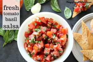 Fresh Tomato Basil Salsa! The irresistible combo of basil, garlic and fresh tomatoes come together in this flavorful, summery salsa.