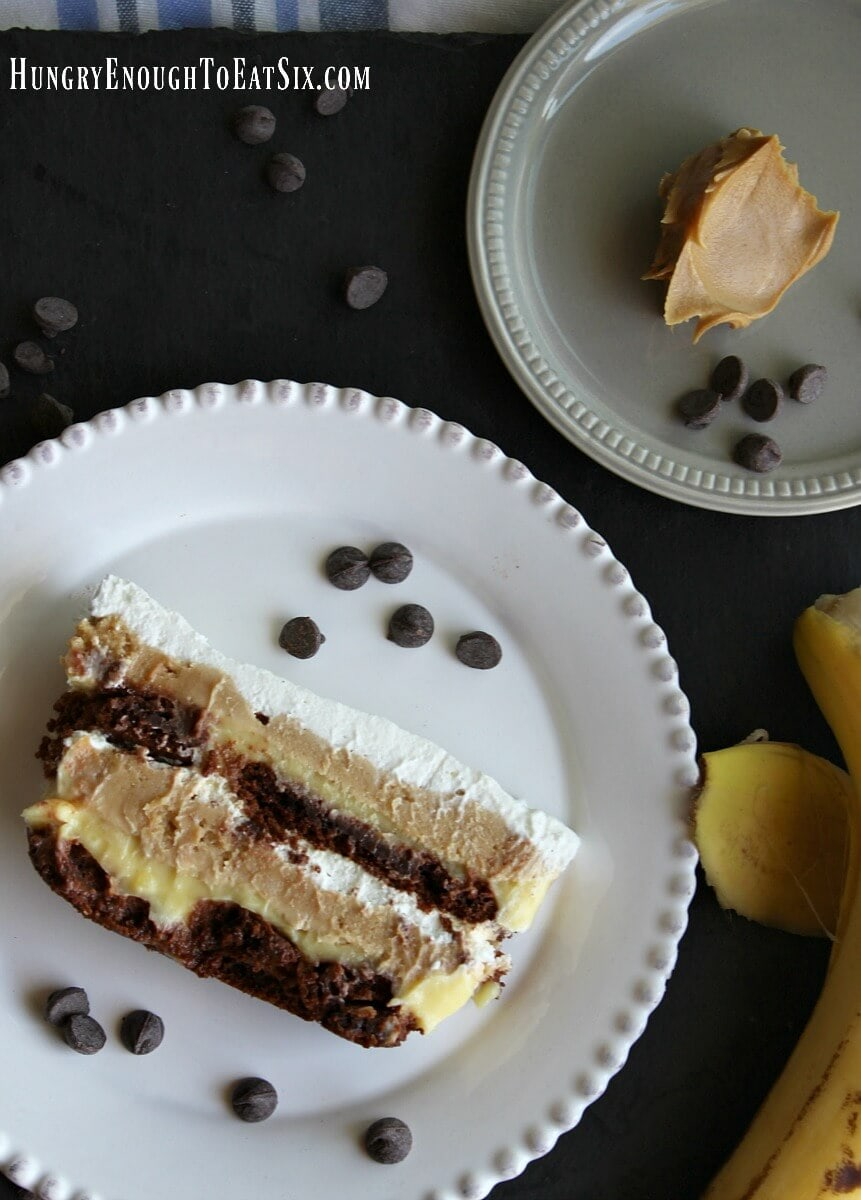 Peanut Butter Banana + Chocolate Icebox Cake! This easy, no-bake dessert is rich with creamy peanut butter and banana fillings, all held together by chocolate cookies.