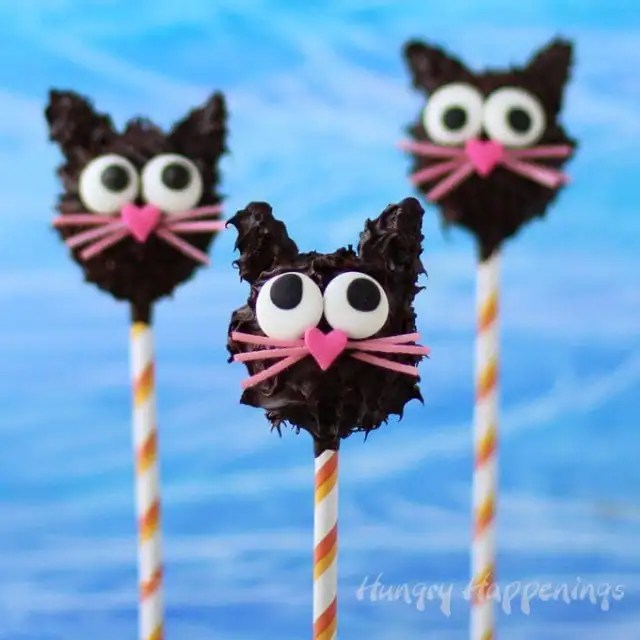 Who needs ordinary peanut butter cups when you can have these adorably cute, decadently rich, Peanut Butter Fudge Filled Black Cat Pops for Halloween? These cute chocolate dipped treats look so sweet that kids will love them, but taste so grown up that adults wont be able to resist.
