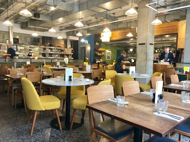 Jamies Italian restaurant Liverpool ONE interior design with yellow chairs and filament bulbs
