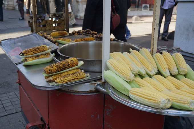 Corn roasted by street vendors