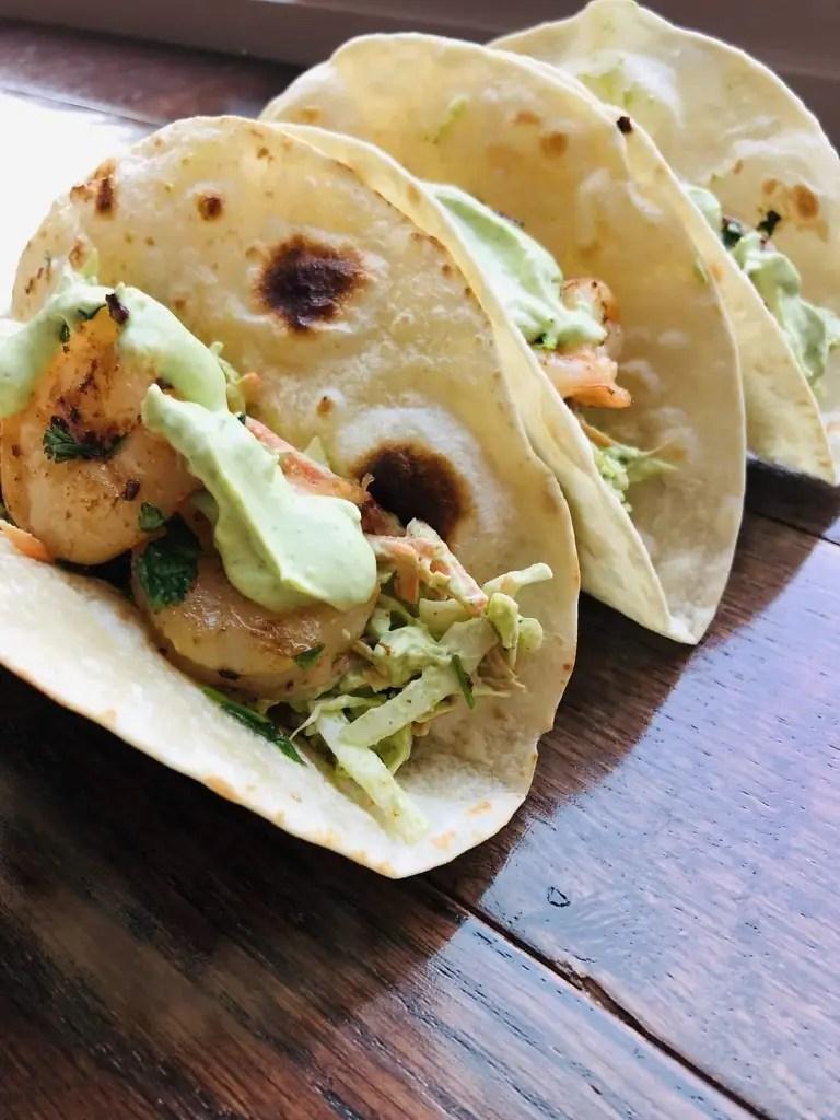 A close up of a cilantro lime shrimp taco