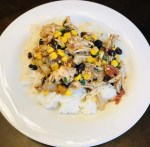 A plate of slow cooker fiesta chicken over rice