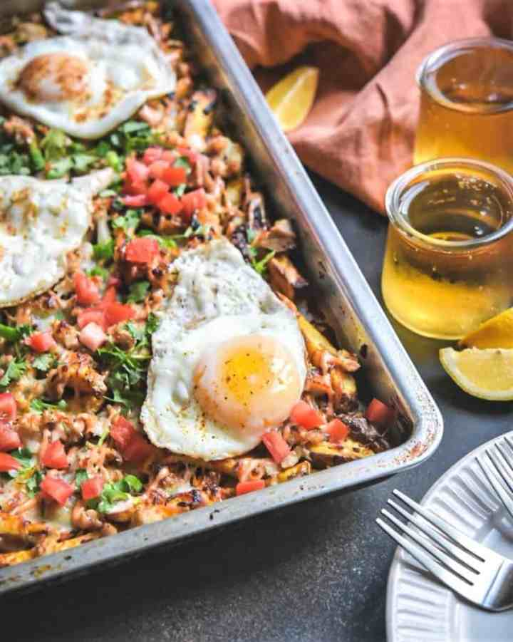 Loaded Cheesy Fries with fried egg and Pollo Asado