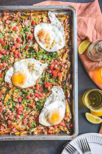 Loaded Cheesy Fries with fried eggs and Pollo Asado