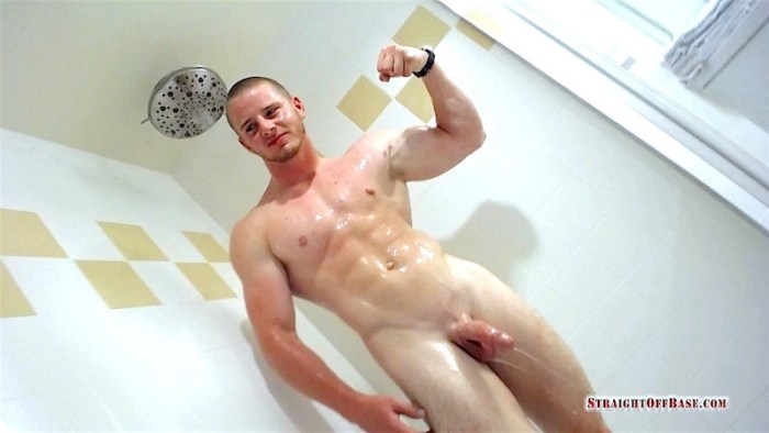 Naked muscle jock in the shower after jerking off