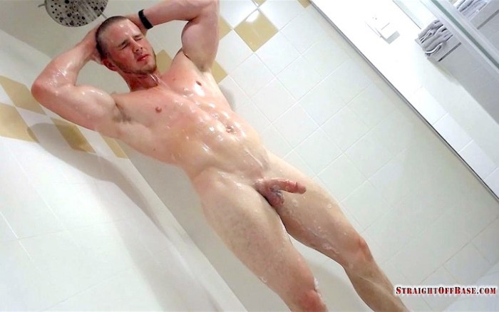 Naked muscle jock in the shower
