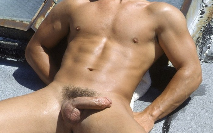 Naked jock with a soft cock in the sun