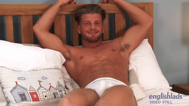 Hot straight guy in underwear on a bed