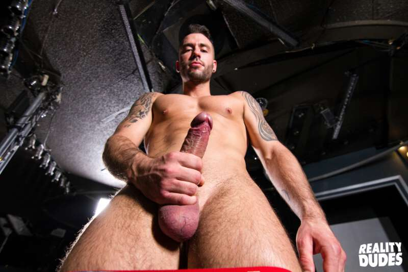 stripper wanking his big uncut cock on stage