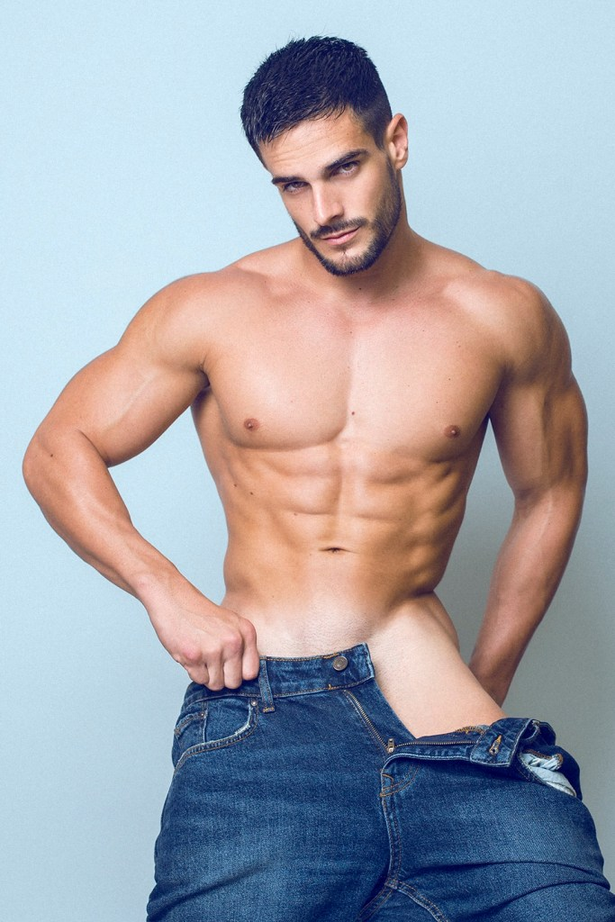 Handsome jock model Jorge Cobian shirtless with jeans open