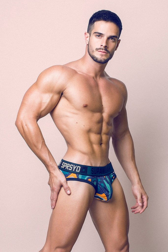 Gorgeous muscled male model Jorge Cobian bulging in underwear for photographer Adrian C. Martin