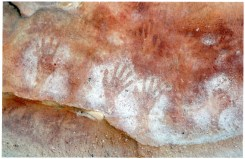 "Photo Credit: Jim Mitchell 2015. Annotation by Brian Laut on reverse side of photograph: ""A clash of tribes? Red ochre hand stencils (Wirangidi) and white ochre hand stencils (coastal tribes) Must have been a meeting place?"""
