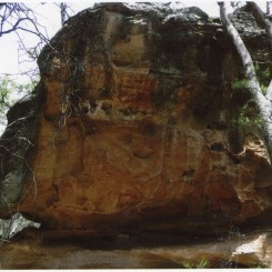 "Photo Credit: Jim Mitchell 2015. Annotation by Brian Laut on reverse side of photograph: ""Cave with baby foot stencils on roof (about 15ft off ground)."""