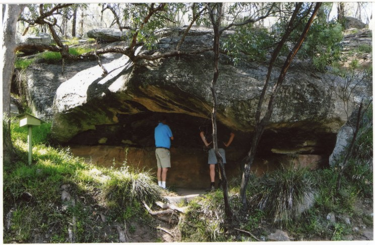 "Photo Credit: Jim Mitchell 2015. Annotation by Brian Laut on reverse side of photograph: ""Cave with axe head stencils and bands of white stripes."""