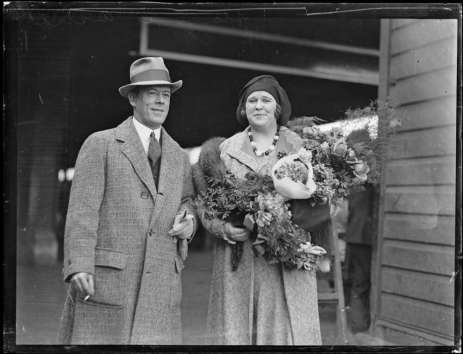 Madame Florence Austral arriving in Sydney and standing beside a man with a large bouquet of flowers, Sydney, 23 May 1930. National Library of Australia
