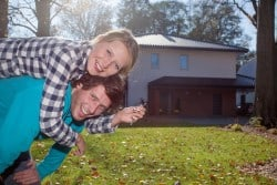 Happy couple with a keys for a new luxury house