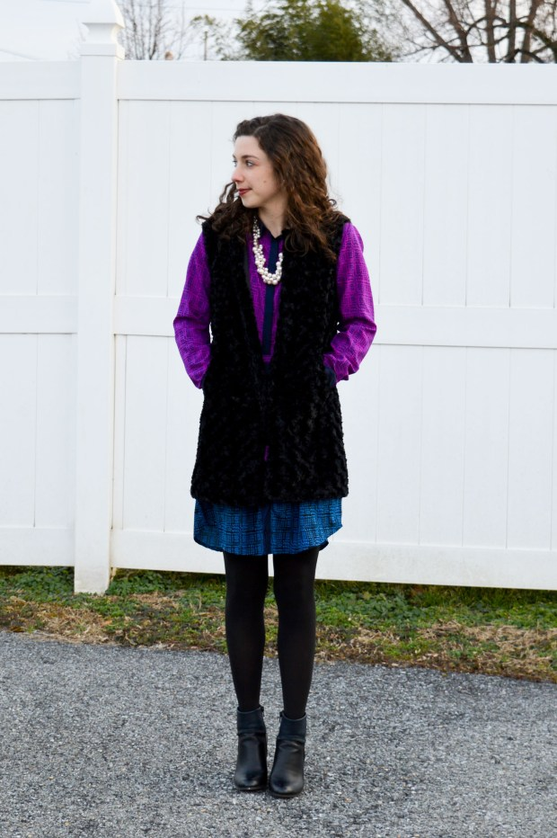 Fur vest layered over a colorblocked shirtdress