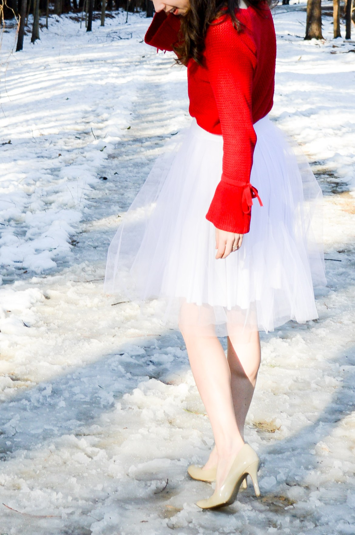 Your guide to wearing white in the winter // White tulle skirt + red sweater on Hunting for Pink Flamingos