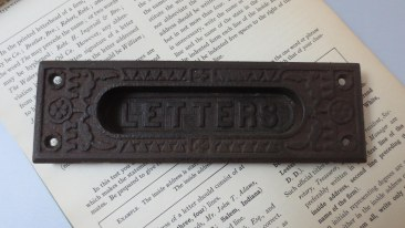 Antique cast iron letter slot