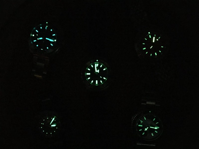 Illuminated watch faces from Seiko, Tag Heuer, Doxa and Zodiac